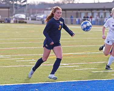 Mars' Ellie Coffield makes a play on a ball in front of Warren's goal in Saturday's PIAA playoff at Mars. Mars topped Warren 8-0. Seb Foltz/Butler Eagle 11/14/20
