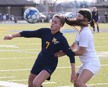 Mars' Gracie Dunaway traps a throw-in to hold off Warren's Lennon Dailey  in Saturday's PIAA playoff at Mars. Mars topped Warren 8-0. Seb Foltz/Butler Eagle 11/14/20