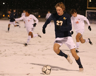 Mars' Dane Beller drives downfield against Cathedral Prep. Seb Foltz/Butler Eagle 11/17/20