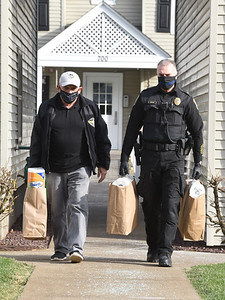 Friends of Saxonburg Police volunteer Bill Hoche, left, and Saxonburg chief of police Joe Beachem deliver groceries to the residents of The Commons of Saxonburg, Thursday, November 19, 2020. Harold Aughton/Butler Eagle