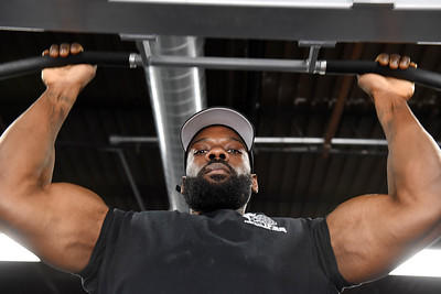 Keith Gary of  Butler bodybuilder who recentyly earned his pro card does a chin up at Harlan's Fitness. Harold Aughton/Butler Eagle
