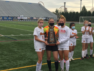 North Catholic girls soccer players, from left, Grace Billmann, Andrea Bean and Tori Michalski accept the runner-up trophy following a 1-0 loss to Bloomsburg in Saturday's PIAA Class 2A final in Hershey.