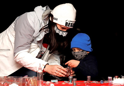 Glen Brunken, 3, and his mother Alex McNeill build a Christmas ornament at Ginger Hill Tavern's ornament and letters to Santa station during Saturday's Slippery Rock Christmas Market. Seb Foltz/Butler Eagle 11.21.20