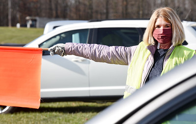 Jeannie Kruidenier of Bradford Woods volunteered at the Pittsburgh Food Bank's food distribution at Lenerville Speedway Tuesday morning, November 24, 2020.