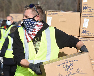 Brian Komoroski of Gibsonia took a day off of work to volunteer at the Pittsburgh Food Bank's food distribution at Lenerville Speedway Tuesday morning, November 24, 2020.