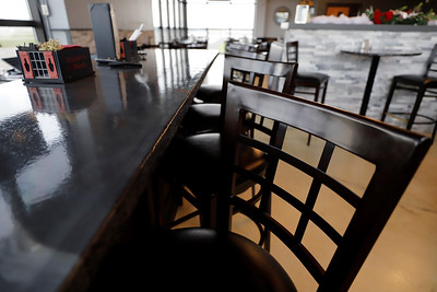 Bar seats sit empty at Serventi's restaurant on Airport Road Tuesday. Due to restrictions from the governor Serventi's management has elected to remain closed Wednesday when they would ordinarily be open. Seb Foltz/Butler Eagle 11/24/20