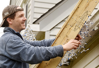 Eric Campbell, a teacher at North Catholic High School, took advantage of his day off and the warm temps to put up the Christmas lights on his house along Saxonburg Road in Summit Township Wednesday morning, November 25, 2020. Harold Aughton/Butler Eagle