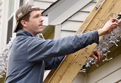 Eric Campbell, a teacher at North Catholic High School, took advantage of his day off and the warm temperatures to put up the Christmas lights on his house along Saxonburg Road in Summit Township Wednesday morning, November 25, 2020.  Harold Aughton/Butler Eagle