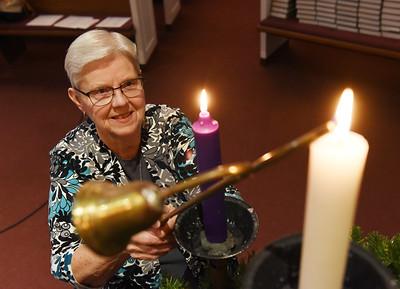 Carol Hines lights the Advent candles at Saxonburg Memorial Presbyterian Church Friday, November 27, 2020. Harold Aughton/Butler Eagle