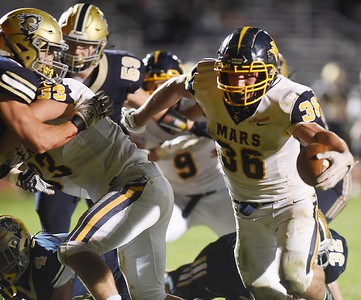 Teddi Ruffner reaches for his 5th touchdown of the game, Friday, October 9, 2020. Harold Aughton/Butler Eagle.