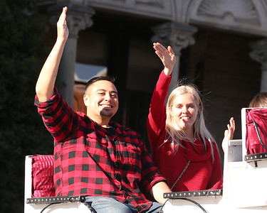 Sean Harcar and Jamie Sears wave from their carriage ride in downtown Butler Saturday. Rides were provided by Misty Lane Performance Horses as part of Butler Downtown's  Small Business Saturday. Seb Foltz/Butler Eagle 11/28/20