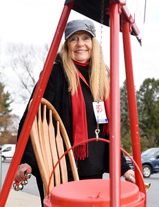 Fran Fennell of Saxonburg rang her bells and danced to the music as she collected donations for the Salvation Army outside Sprankle's Neighborhood Market Friday morning, November 27, 2020. Harold Aughton/Butler Eagle.