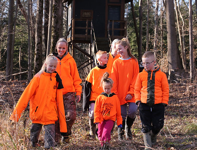 The Osborns walk home from the family's backyard, tree-house-style hunting blind Saturday at their home near Grove City. Parents Amber and Doug Osborn take turns hunting with all but their youngest child Willa, 4, (front).   Left to right: Bri,9, Amber (Mother), Kyle, 10, Willa, 4, Doug (father, back) Maddie,11, and Jude Osborn, 7.  Seb Foltz/Butler Eagle