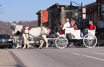 Mindy Stoops of Misty Lane Performance Horses drives a horse-drawn carriage across Main Street Saturday as part of Butler Downtown's Small Business Saturday. Seb Foltz/Butler Eagle 11/28/20