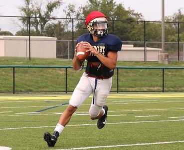 Freeport quarterback Zach Clark rolls out to pass during a team practice Thursday. Seb Foltz/Butler Eagle Sept. 3 2020