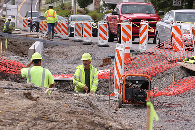 PennDot subcontractors work on the turning lane expansion in Slippery Rock Wednesday. Seb Foltz/Butler Eagle. 09/30/20
