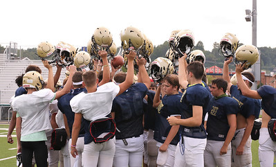 Freeport football players raise helmets after practice. Seb Foltz/Butler Eagle   (Sept. 3 2020) Thursday