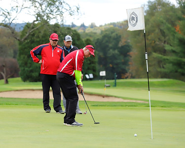 John Kraus of Slippery Rock watches his put head toward a hole with Todd Simmons and Doug Simmongs Wednesday on the front nine at Slippery Rock Golf Club & Events Center Wednesday. The club hosted a Make A Wish fundraising tournament. Seb Foltz/Butler Eagle. 09/30/20