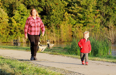 Gannon Harrison, 2, of Valencia walks along the recreation trail at Glade Run Lake Park with his grandmother Kathy Heckel  Thursday during the Glade Run Lake Conservancy's food truck night event. Seb Foltz/Butler Eagle 10/01/20