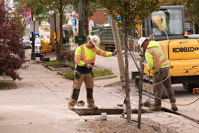 Construction crews work on a water line project on Slippery Rock's Main Street Wednesday, part of two separate road projects in the town. Seb Foltz/Butler Eagle 09/30/20