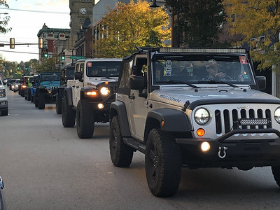 Jeeps bearing Trailfest stickers on their windshields travel down Main Street in Butler in October 2, 2020. Photos by Lauryn Halahurich/Butler Eagle
