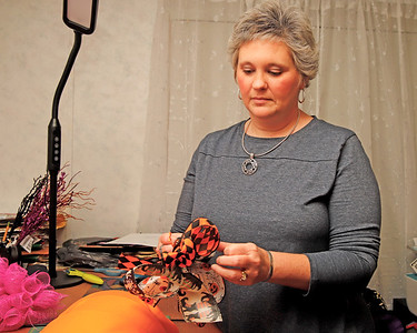 Tina Ruffner ties ribbons for one of her homemade wreaths. Ruffner made thank you wreaths for family friends whom supported her during her cancer fight. Seb Foltz/Butler Eagle 09/30/20