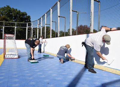 From far left, Penreco employees Sue Klingler, Ryan Smith, Mary Hohn, and Steve Powers worked together painting the deck hockey ring at the Butler Twp. Park Tuesday, October 6, 2020.  They were joined in their efforts by abot 8 other volunteers from C.W. Howard Insurance and AGR Interationa for the United Way's Day of Caringl.