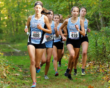 Gabby Kutchma (408) and Bailey Royhab (410) lead a pack of Seneca Valley girls cross country runners in the first heat of Tuesday's home meet. Seb Foltz/Butler Eagle 10/06/20