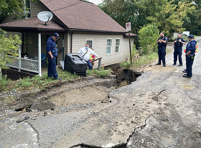 Part of the street on Marvin Street collapses when a water main broke on Wednesday.