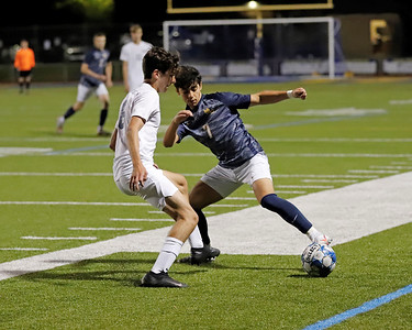 Mars' Nabil Lahlou works around a Freeport defender Thursday night. Lahlou scored the opening goal in the win. Seb Foltz/Butler Eagle 10/08/20