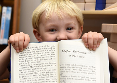 Finnian Thompson, 3, of Slippery Rock recently visited the community library with his mother Emily Thompson where he discovered the library's new collection of large print books.