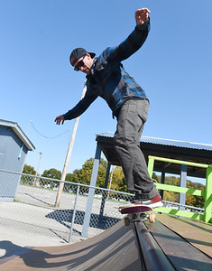 Volunteer Josh Bobby of Butler takes a break and does a backside 5-0 on one of the skate ramps at Father Marinaro park Friday, October 10, 2020.