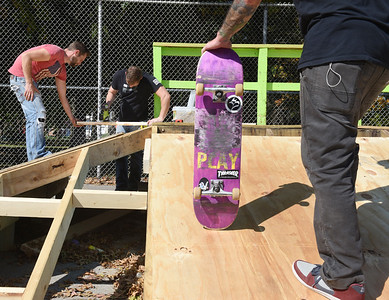 Brothers Andrew and Rob Parker work together on the Pyamid corner skate ramp while Josh Bobby looks on at Father Marinaro Park Friday, October 9, 2020.