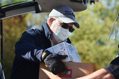 Bob Eidenshink of Mars volunteed loading cars at the Lighthouse Foundation's food pantry Thursday, October 8, 2020. Harold Aughton/Butler Eagle