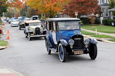 Classic cars drive through neighborhoods during the Zelienople Library parade Saturday. Seb Foltz/Butler Eagle