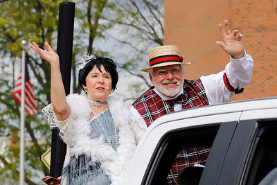 Dressed in period costumes, Deb Wagner and Ken Doerbecker of Deb & Ken's  Sentimental Journey sing to parade goers during Zelienople Library's 100th anniversary parade. Seb Foltz/Butler Eagle