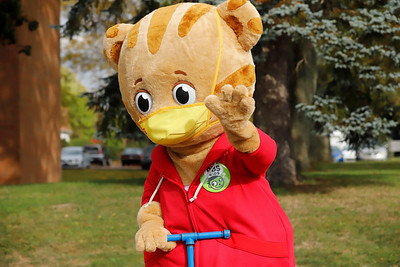 Daniel Tiger Waves to spectators at Saturday's Zelienople Library 100th anniversary parade. Seb Foltz/Butler Eagle