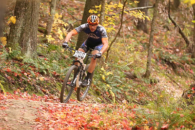 Joe Fraas rounds a bend racing in the veteran expert 40+ class during Sunday's Month of Mud mountain bike race at Alemeda Park. Seb Foltz/Butler Eagle 10/11/20