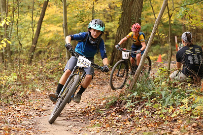 Everett Radock rounds a corner racing in the 14-and-under class at Sunday's Month of Mud mountain bike race at Alemeda Park. Seb Foltz/Butler Eagle 10/11/20