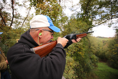 Ken Minnear of West Sunbury fires a shot at a clay target during Saturday's Butler PM Rotary Robin's Home fundraiser. Seb Foltz/Butler Eagle