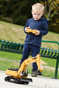 Chase Pappas, 3, of Butler plays with his remote controlled excavator Monday afternoon with his father Nick Pappas at Butler Memorial Park, Monday, October 12, 2020.