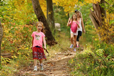 Briella Vitalbo,5, of Zelienople leads her family on a fall walk on the North Country Trail at Moraine State Park Saturday. Seb Foltz/Butler Eagle 10/10/20