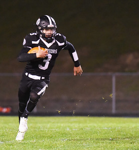Moniteau's David Stamm, #3, looks for running room in the second quarter. Harold Aughton/Butler Eagle