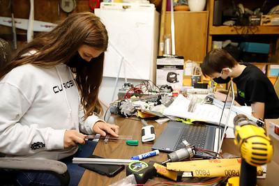 Mars Robotics team members Lindsey Gourash, 15, and Mitchell Kulfan, 14, work on the prototype designs for this year's competition robot. Seb Foltz/Butler Eagle 09/24/20
