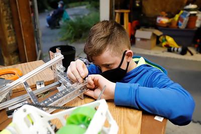 Jacob Noe, 12, works on a prototype shooting mechanism for this year's Mars Robotics Team robot. Seb Foltz/Butler Eagle 09/25/20