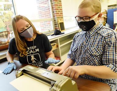 Kadyn Czepiel, a 6th grader at Dassa McKinney Elementary, practices typing with a Braille typewriter. Harold Aughton/Butler Eagle.
