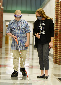 Kadyn Czepiel, a 6th grader at Dassa McKinney Elementary, practices using his cane with Jessica Sloan, visional impaired instructor in the Moniteau School District, Tuesday, October 13, 2020.