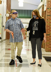 Kadyn Czepiel, a 6th grader at Dassa McKinney Elementary, practices using his cane with Jessica Sloan, visional impaired instructor in the Moniteau School District, Tuesday, October 13, 2020. Harold Aughton/Butler Eagle.