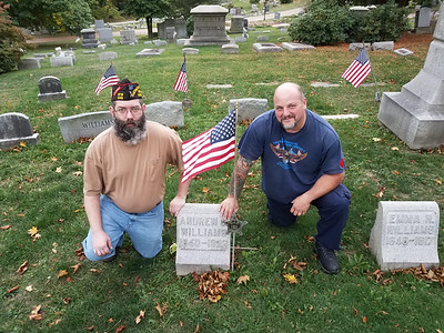 Jason Tindall, commander of VFW Post 249 in Butler, left, and Chad Slater, a Civil War re-enactor, show the gravestone of Civil War veteran, state legislator and Butler resident Andrew Williams in North Side Cemetery, Slater and the VFW are working to get Williams' grave a military headstone. ERIC FREEHLING/BUTLER EAGLE