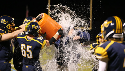 Mars players douse head coach Scott Heinauer in celebration of his 200th win Friday night. Seb Foltz/Butler Eagle